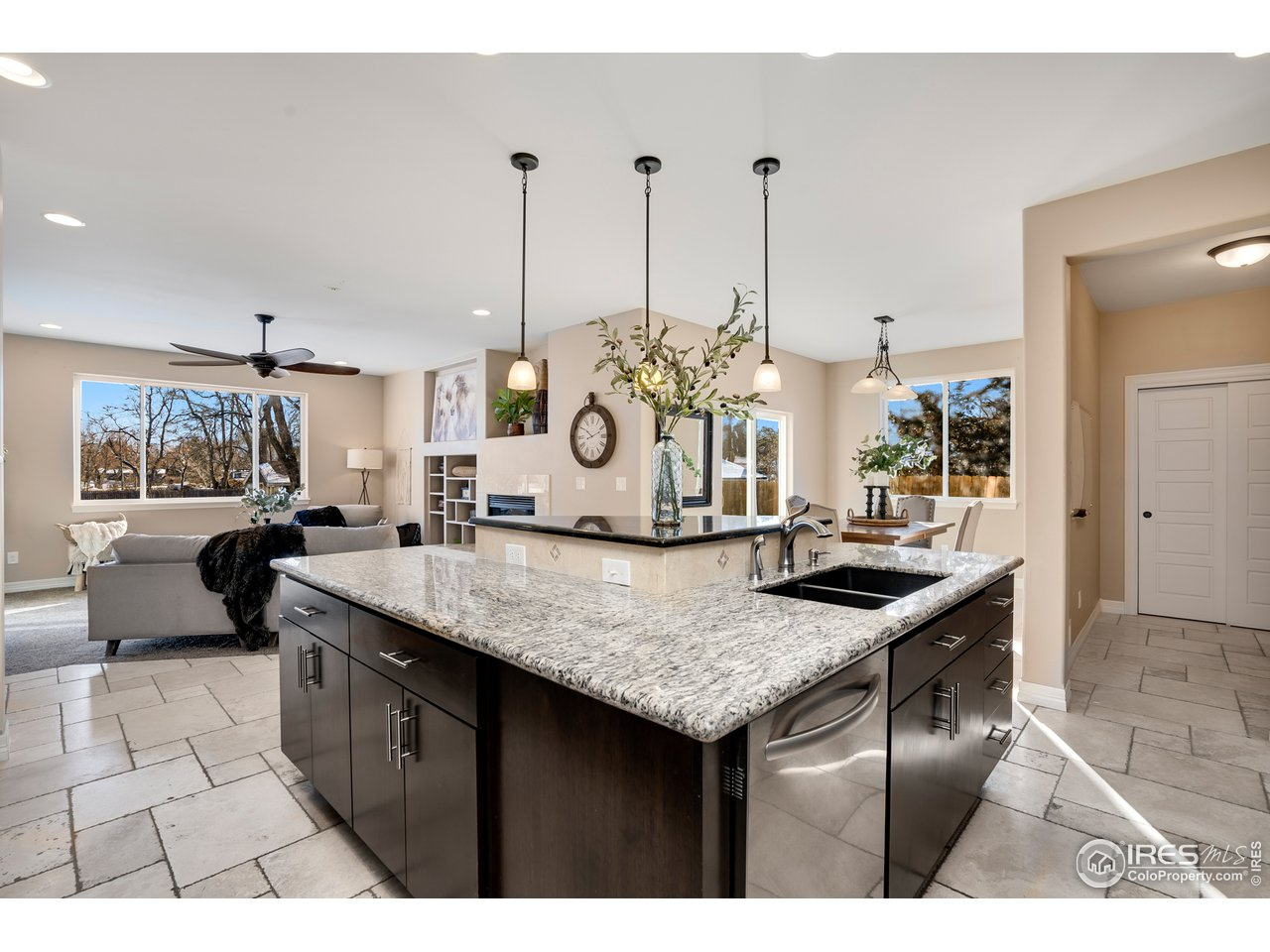 Travertine floors, granite counters, and S/S appliances included.