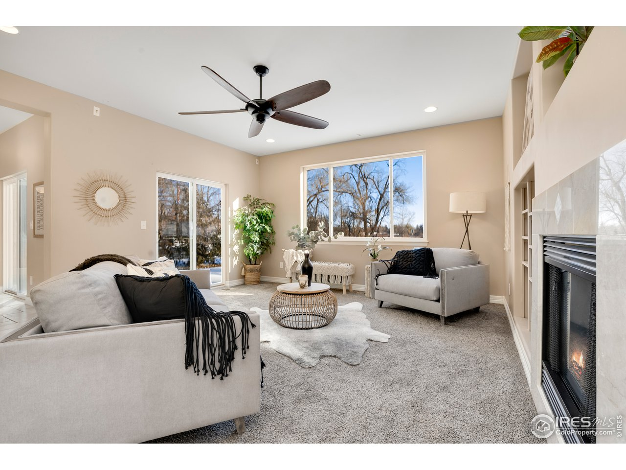 Great room with cozy fireplace opens to 2nd patio