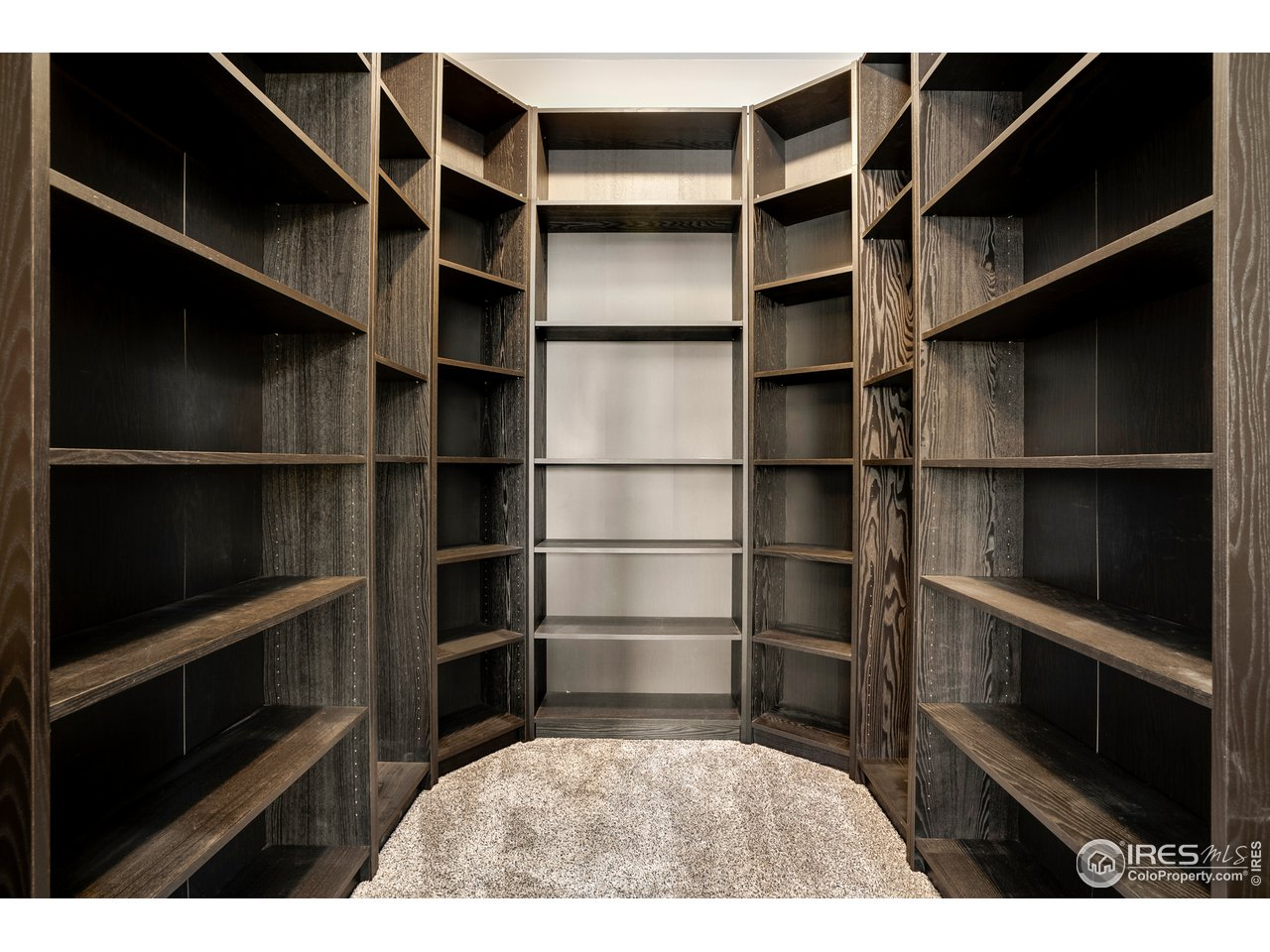 Custom shelving included in den/office closet
