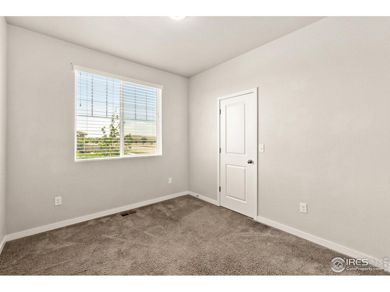 Bedroom 3 features a walk-in closet