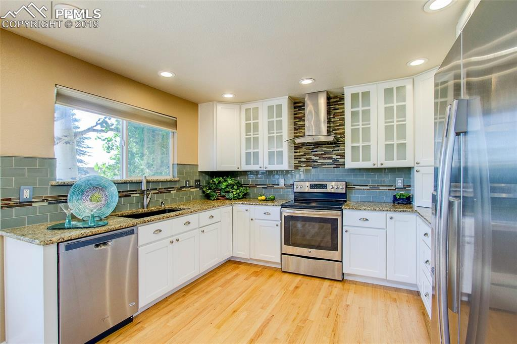 Granite Counters with beautiful Glass Cabinets