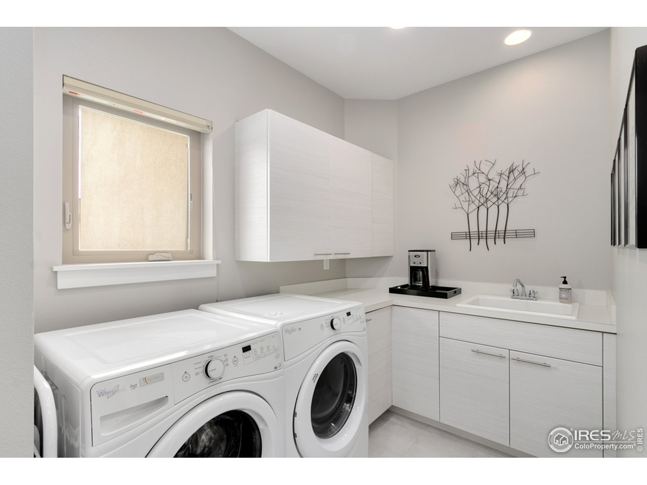 Upper level Laundry room with Sink