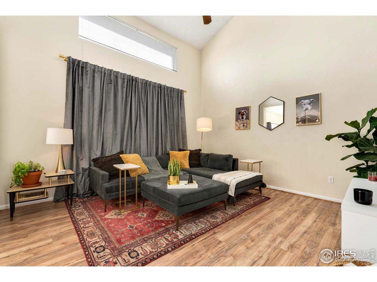 Vaulted Ceiling Living Room w/ Wood Flooring