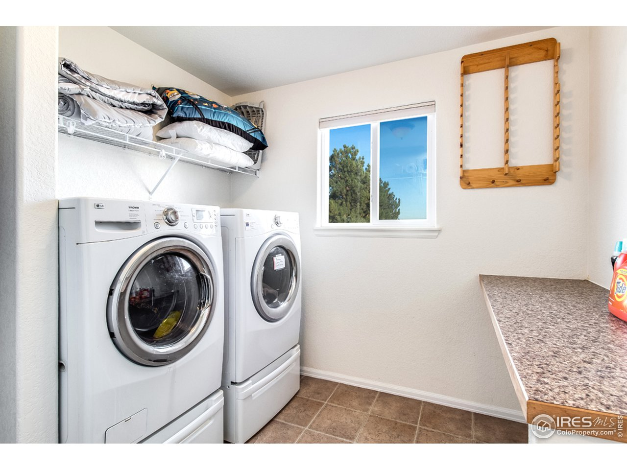 Laundry Room with Folding Table , Hanging Rack and Storage Space