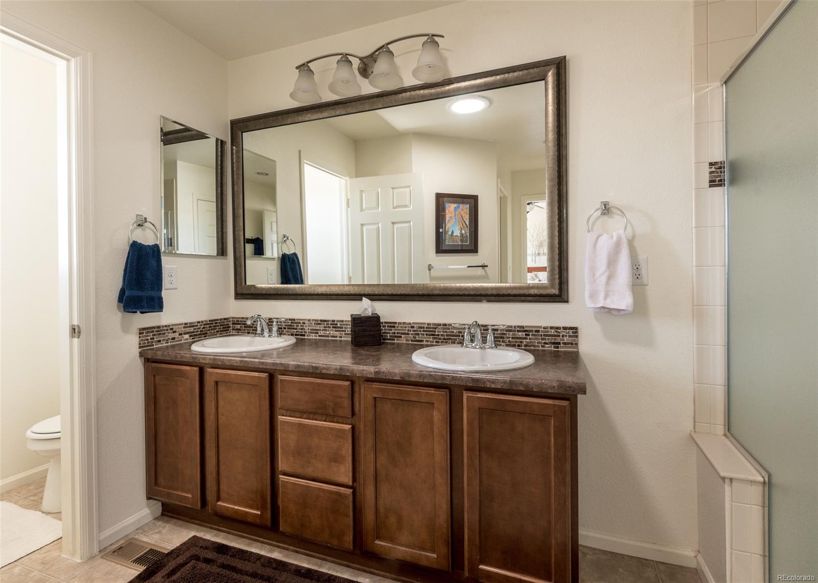 Daul vanity sinks and separate toilet room