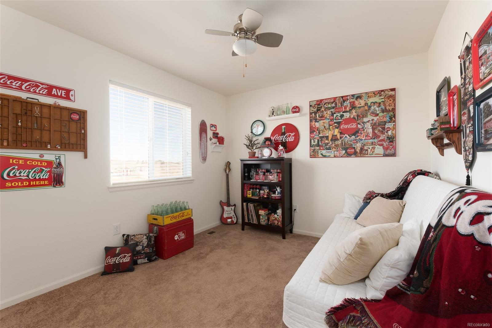 Third additional bedroom located on upper level.