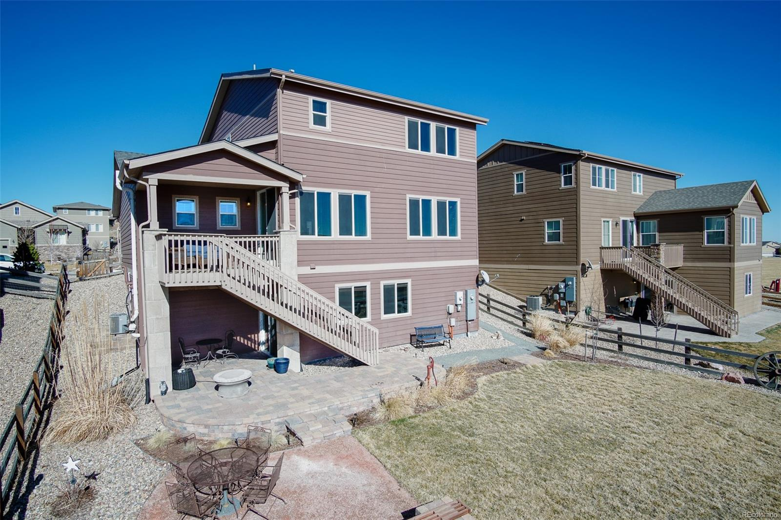 Large oversized backyard with brick patio. Perfect for grilling outside and enjo