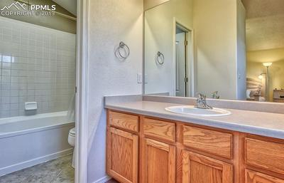 Master bath has separate garden soaker tub, shower & w/c for privacy.