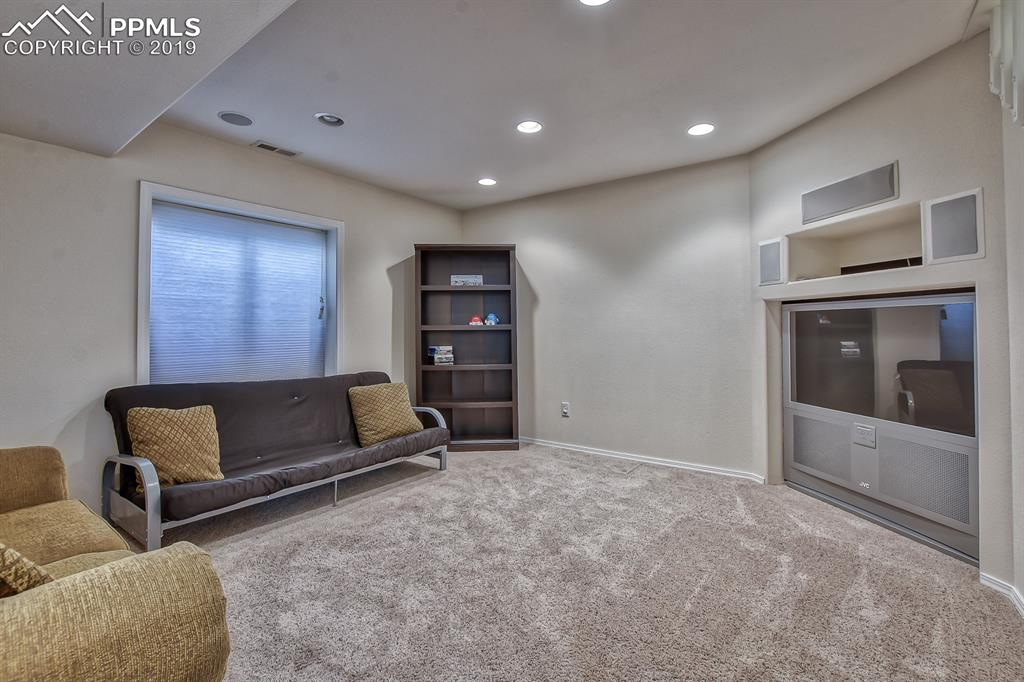 Basement entertainment area with large screen tv (stays)