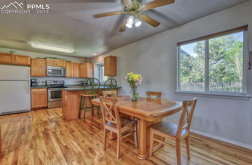 Fabulous hardwood floors flow through this open dining, kitchen and breakfast bar area