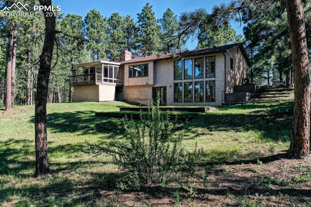 Welcome home to your totally renovated rancher on almost five beautiful acres.