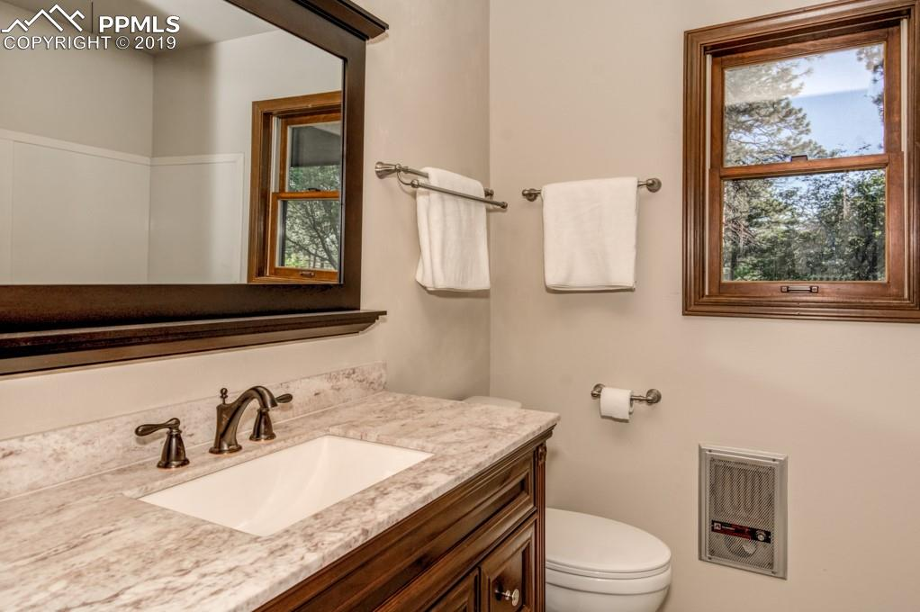 Bathrooms feature new cabinets, counters fixtures and toilets.