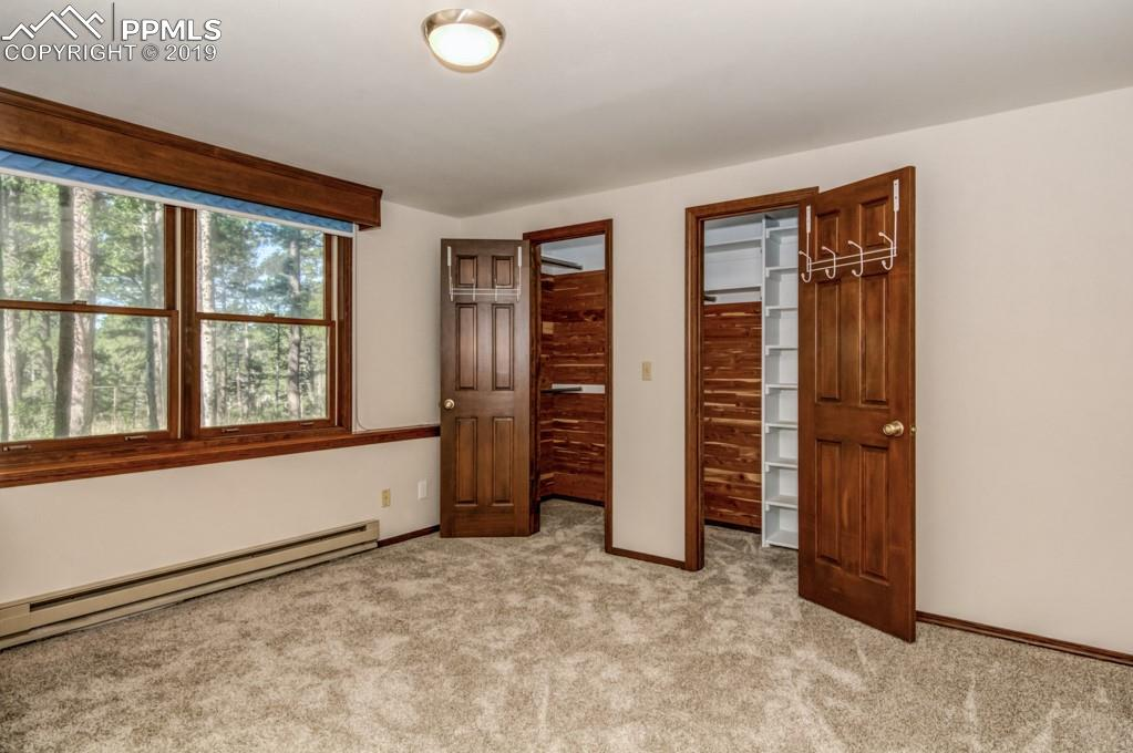 Master bedroom features a double cedar lined closit