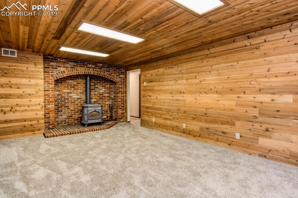 Wood stove in basement family room