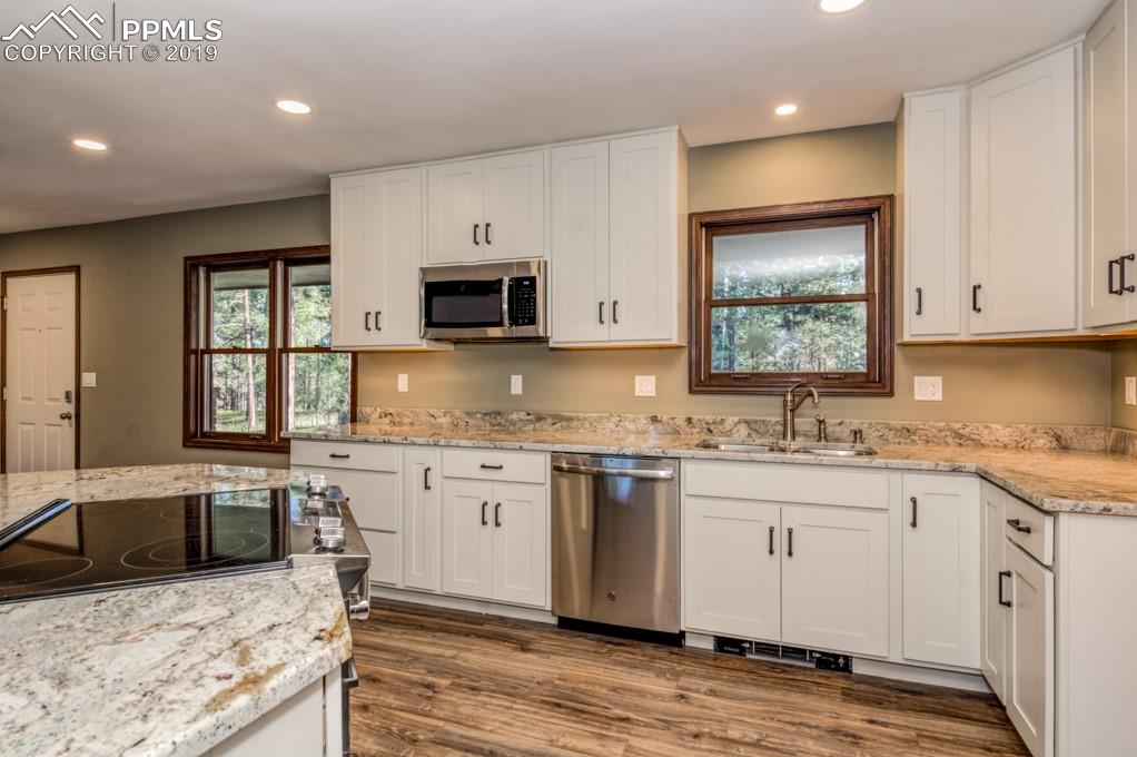 Gorgeous Granite Slab Counter tops with under-mount double sided Stainless Steel Sink