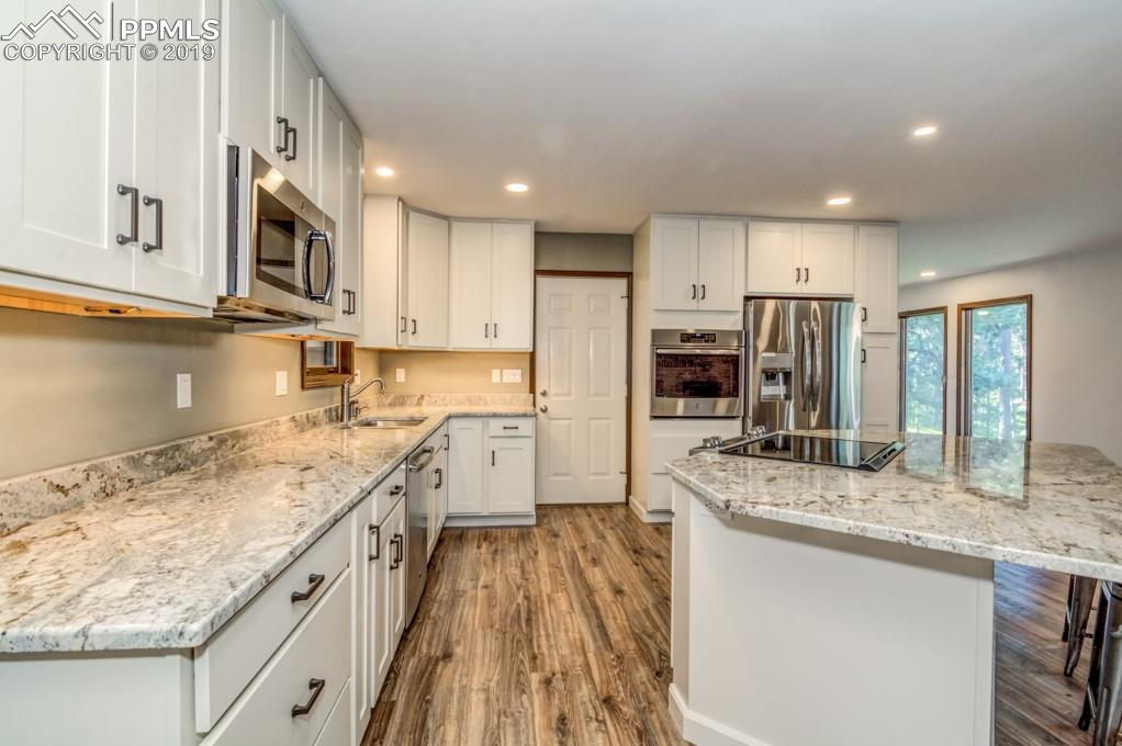 Antique White Custom Cabinetry accented with contrasting Handles & Pulls