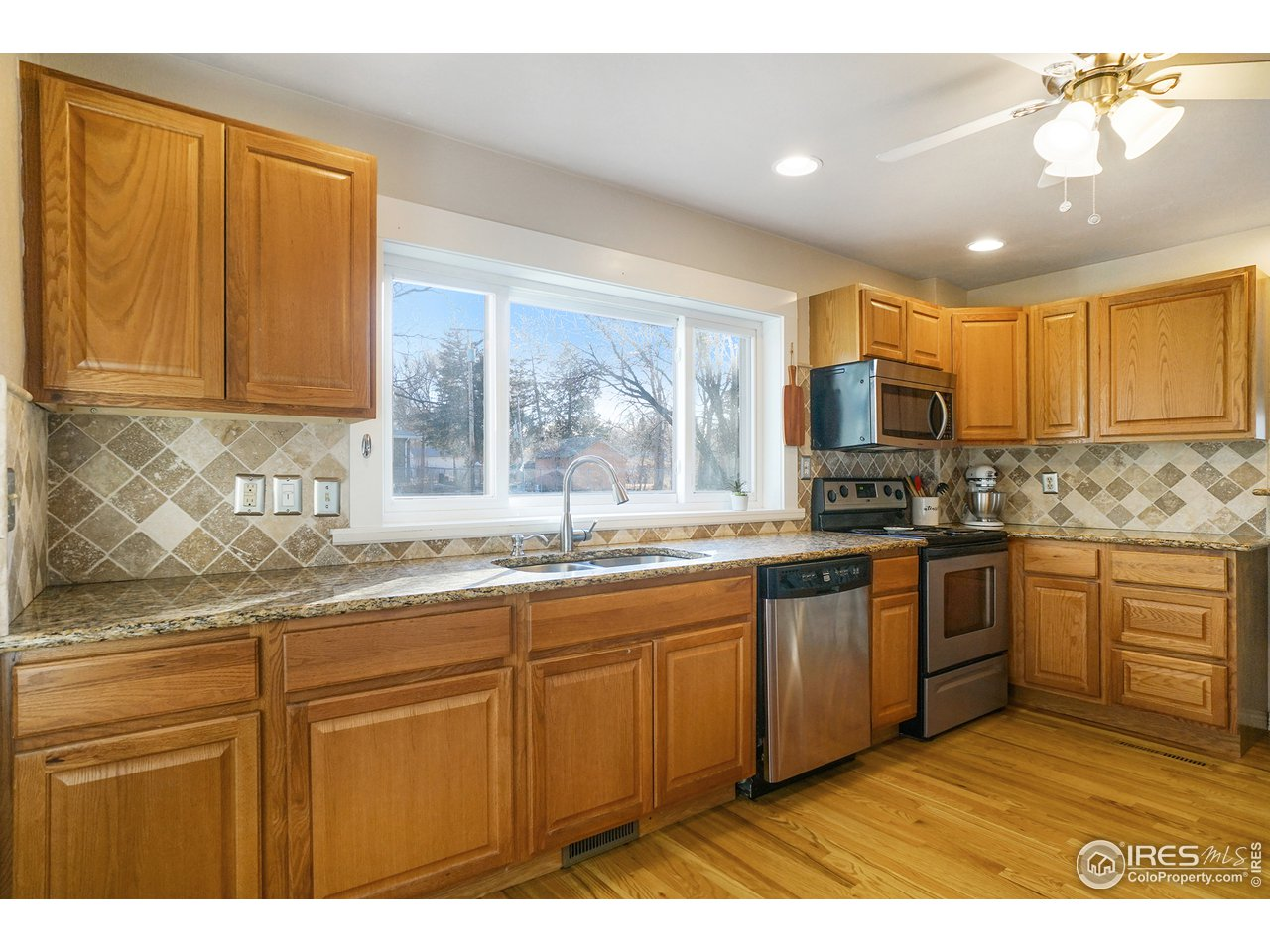 Large kitchen with granite counter tops.