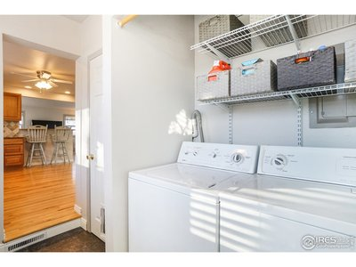 Recently renovated laundry area with new floors.