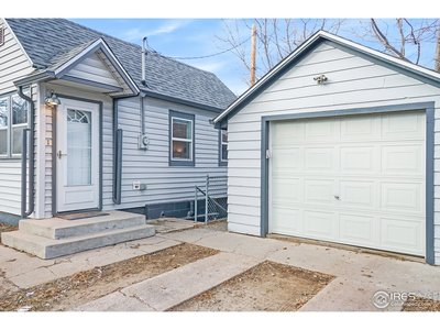 Detached garage includes opener and coded keypad.