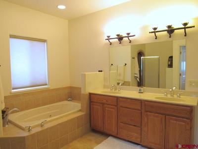 Master Bath Features Jetted Tub, Jack & Jill Sinks
