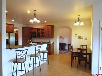 Kitchen with Breakfast Nook and Bar Area