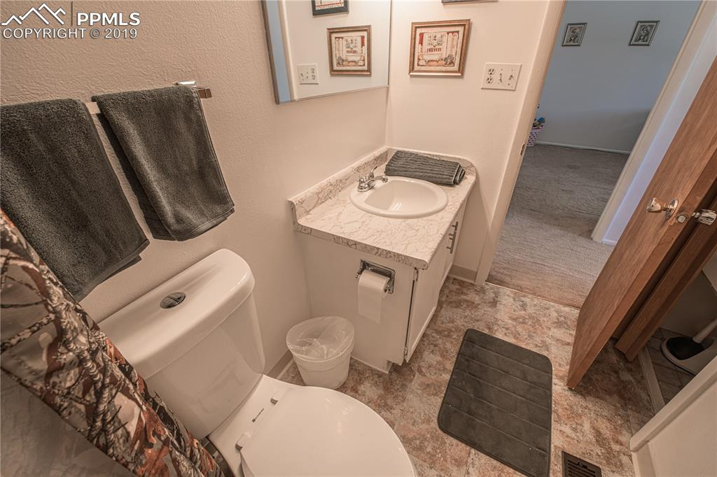 Upper level bath (with new toilet, Sink & flooring)