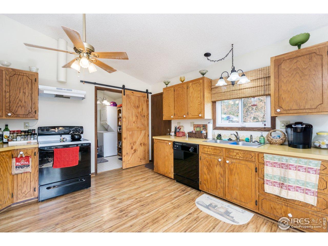 Kitchen with barn door to 1/2 bath