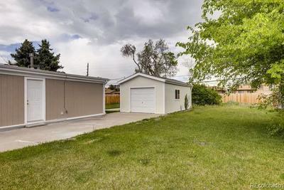 Spacious Detached garage, huge yard and garden area.