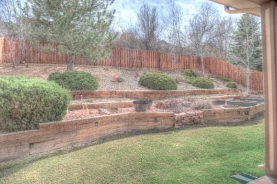 Backyard professionally landscaped w raised garden