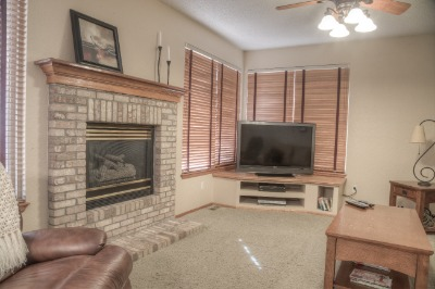 Family Room with built-in and gas fireplace
