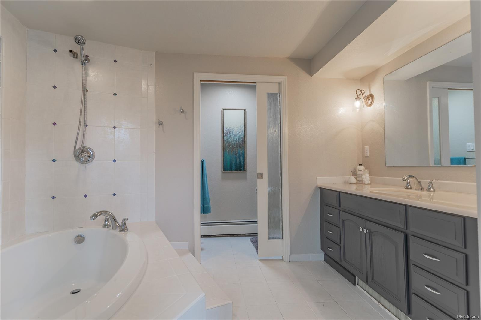 Master bath with over-sized soaking tub and large vanity with separate lavatory.
