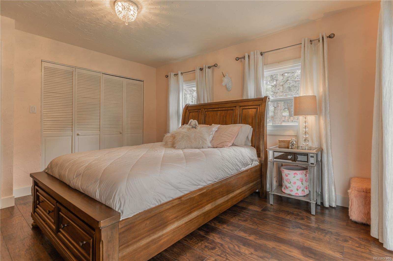 Large secondary bedroom with patio access.