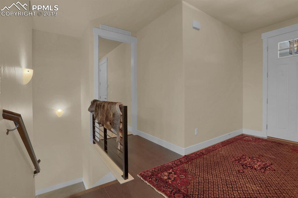 Entryway and Laundry room, Stairs lead to lower floor