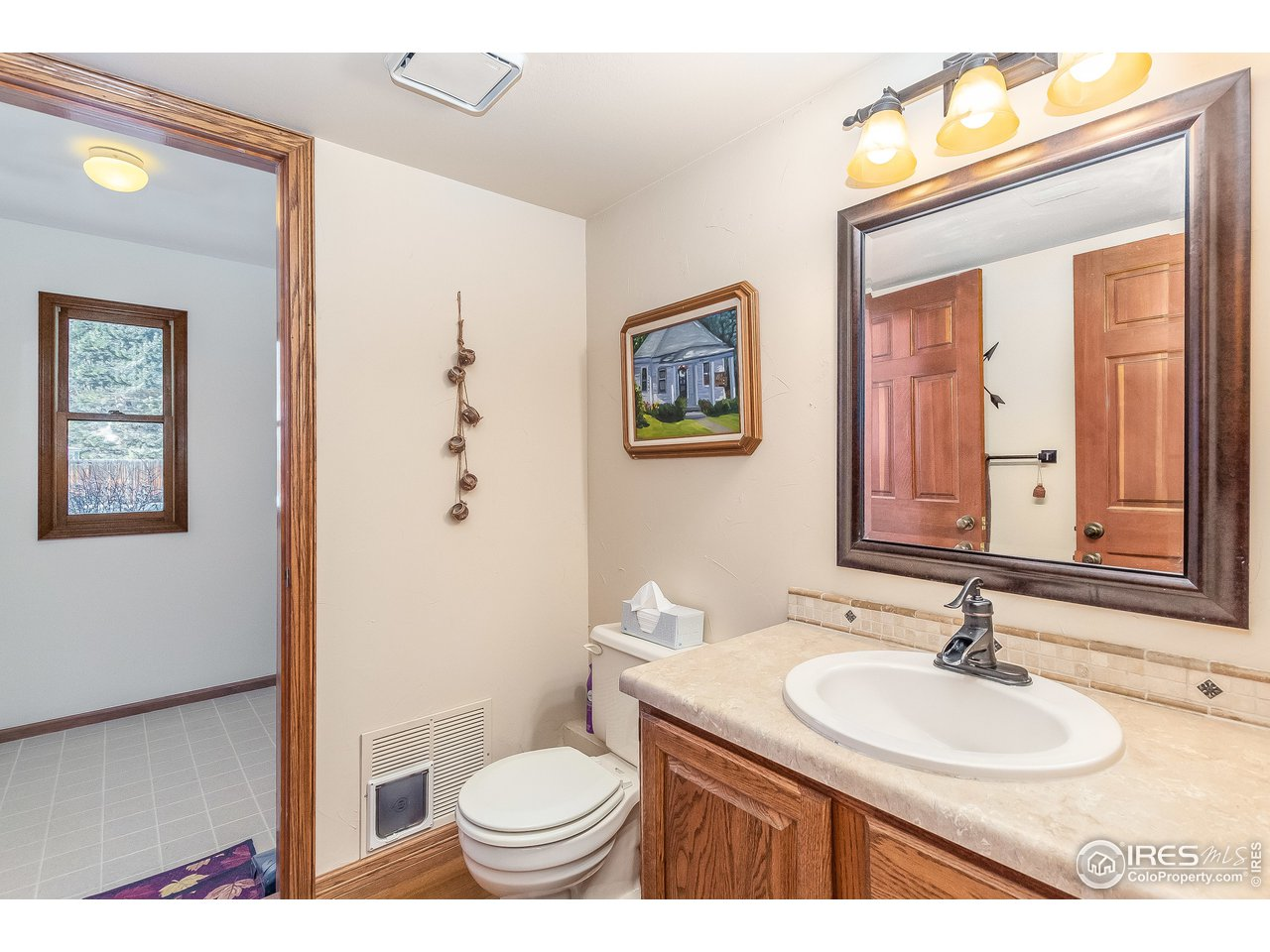 1/2 bath and laundry room complete with sink.