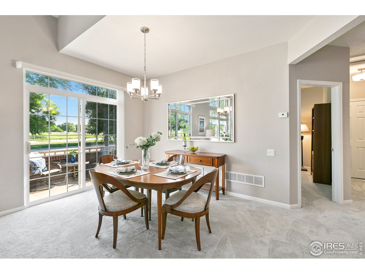 Dining Room with Sliding Doors to enclosed patio overlooking the park.
