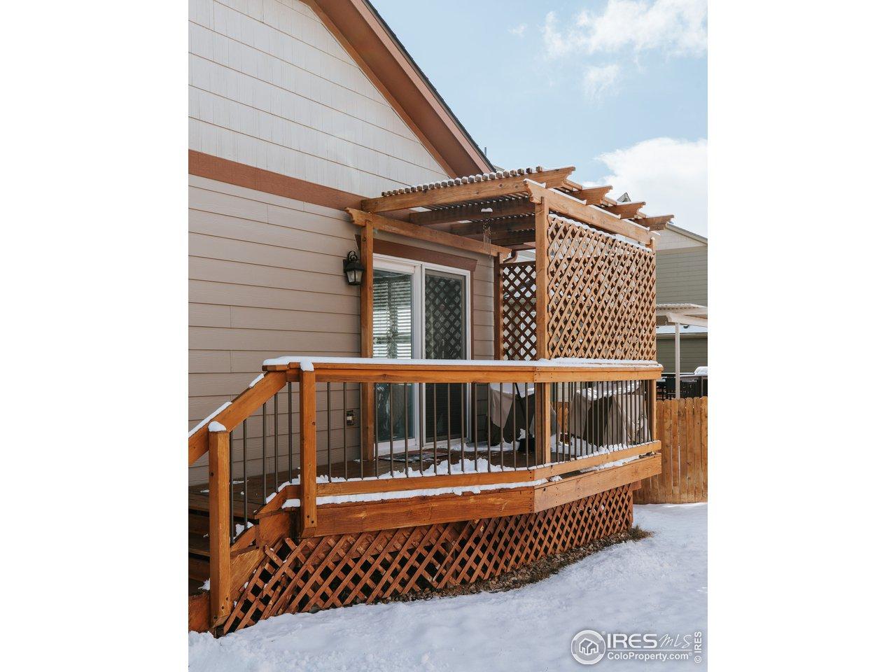 Great addition of wood deck & pergola