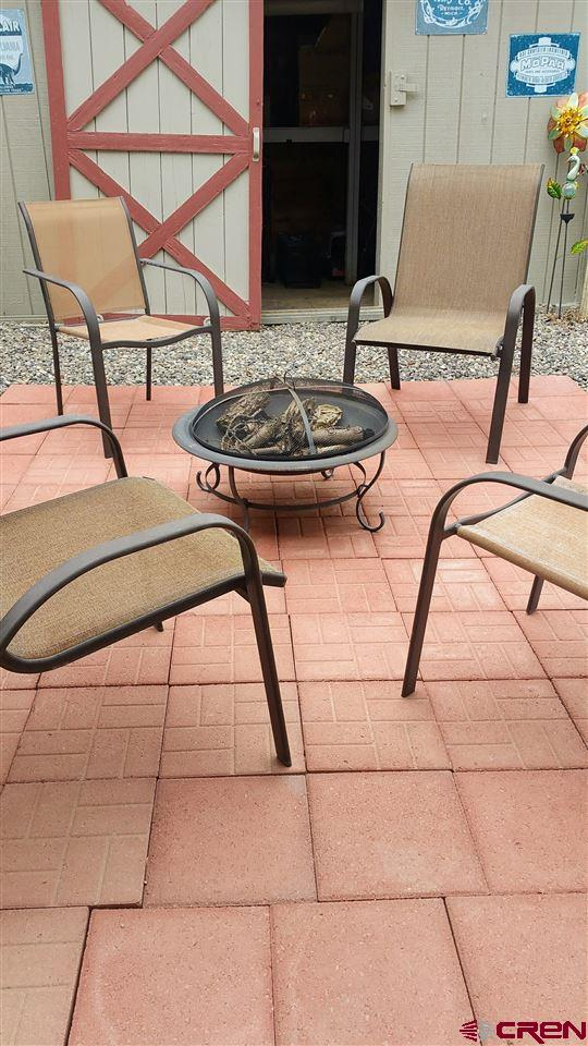 FIREPIT SITTING AREA BY THE PATIO