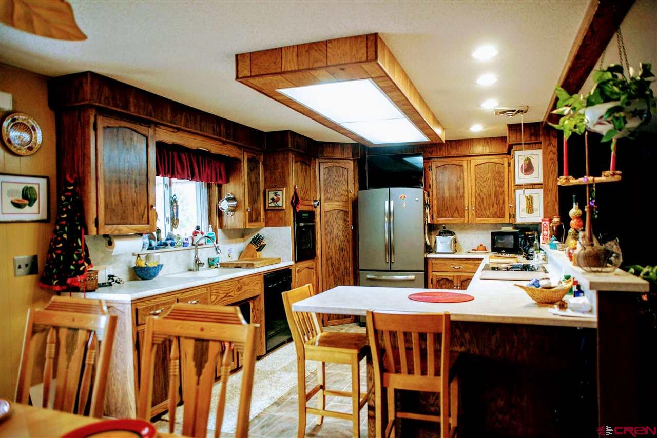 KITCHEN ON MAIN LEVEL WITH LOTS OF COUNTER SPACE