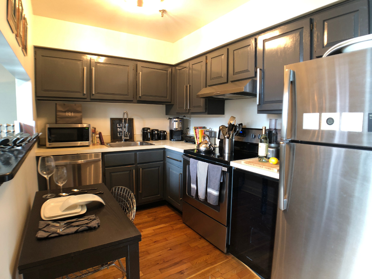Stainless steel appliances including a dishwasher, wine cooler, remodeled cabine