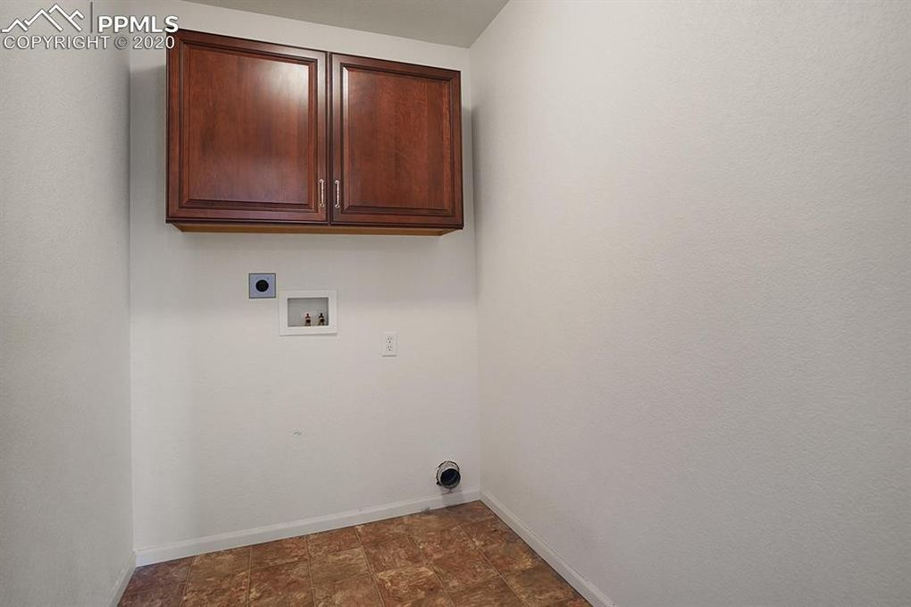 Laundry Room with Cherry cabinets is upstairs!