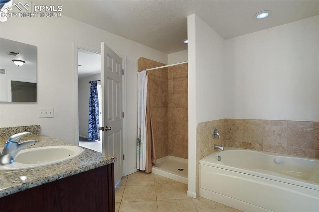 Jetted tub, separate shower, tile floor!