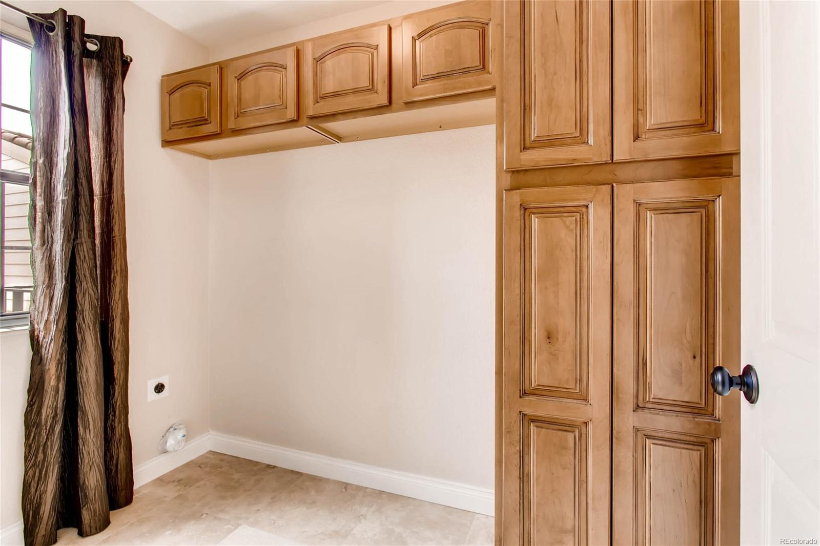 LARGE LAUNDRY ROOM COMPLETE WITH STORAGE CABINETS