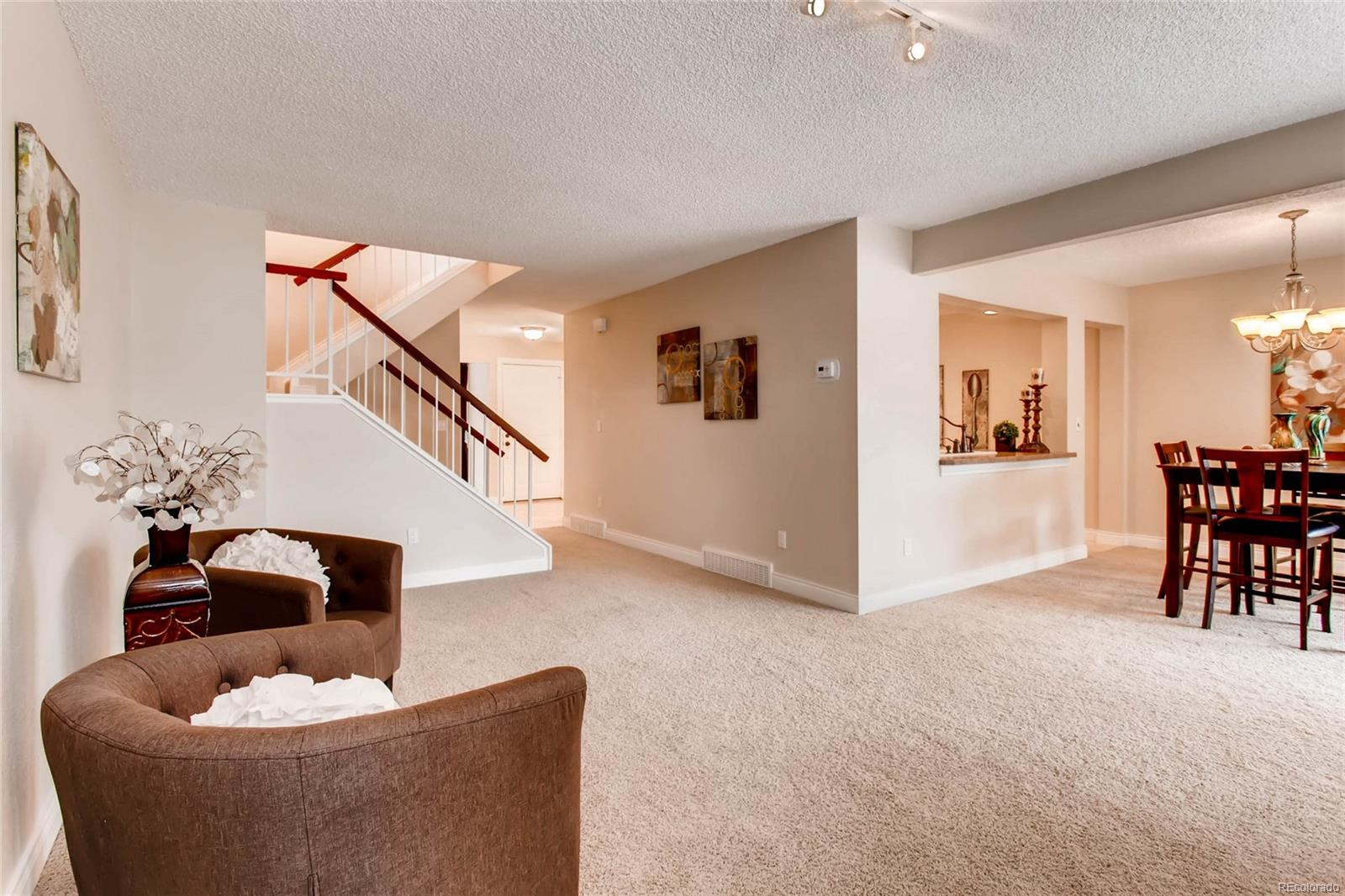 LIVING ROOM OVERLOOKING DINING ROOM, FOYER, AND STAIRS