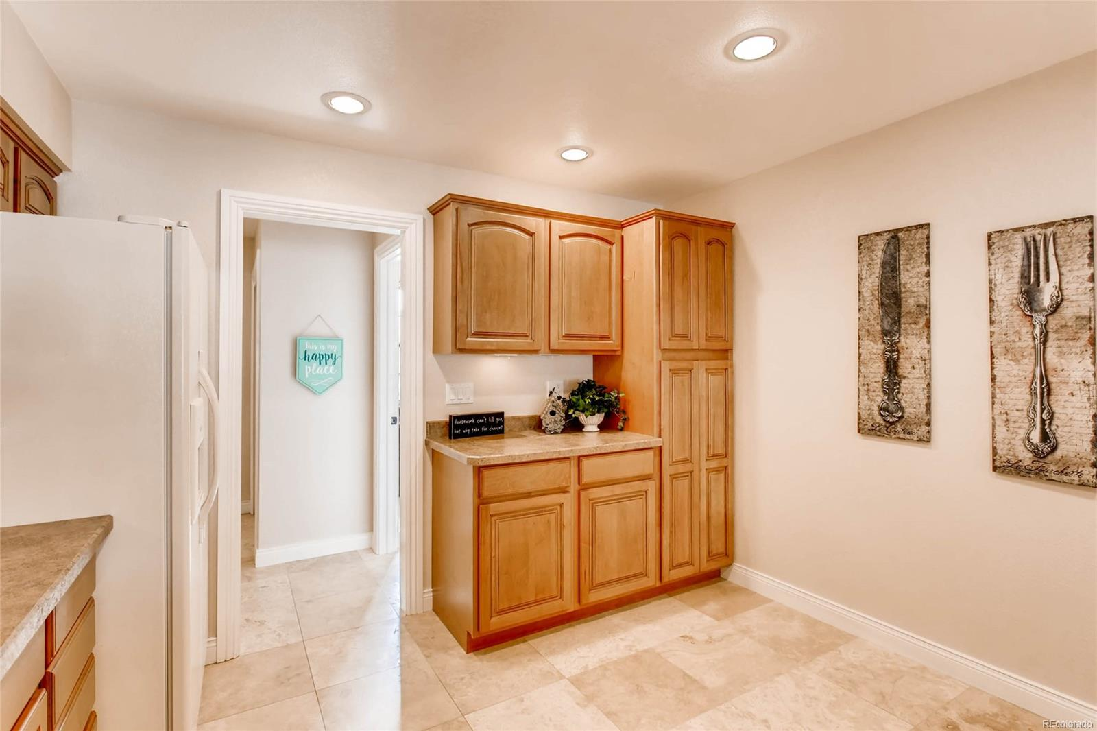MORE KITCHEN CABINETS AND PANTRY, WITH SPACE FOR A BREAKFAST NOOK IN THE KITCHEN