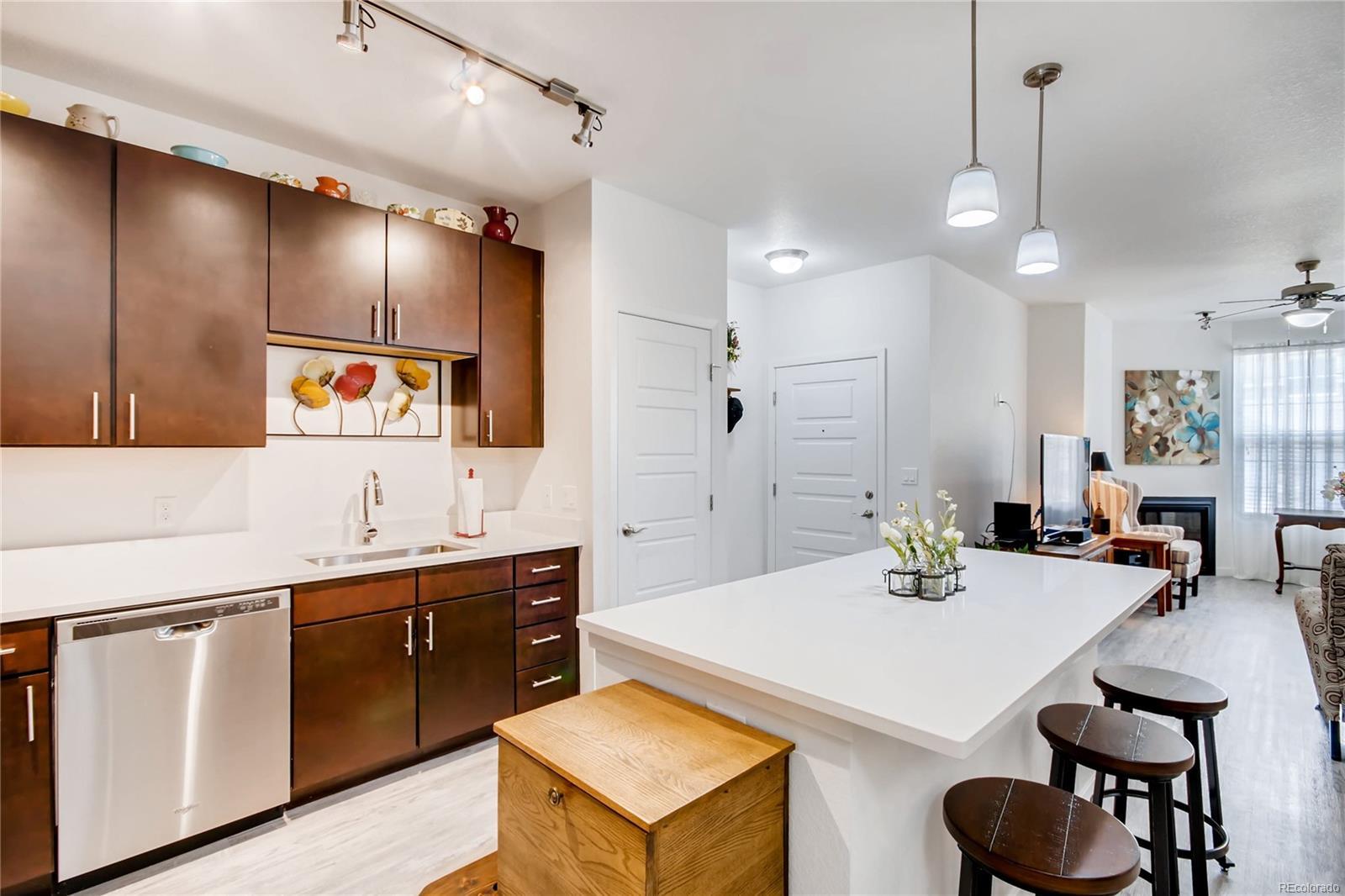 BEAUTIFUL OPEN MODERN ,KITCHEN WITH STAINLESS STEEL APPLIANCES AND SLAB GRANITE COUNTERS AND ISLAND