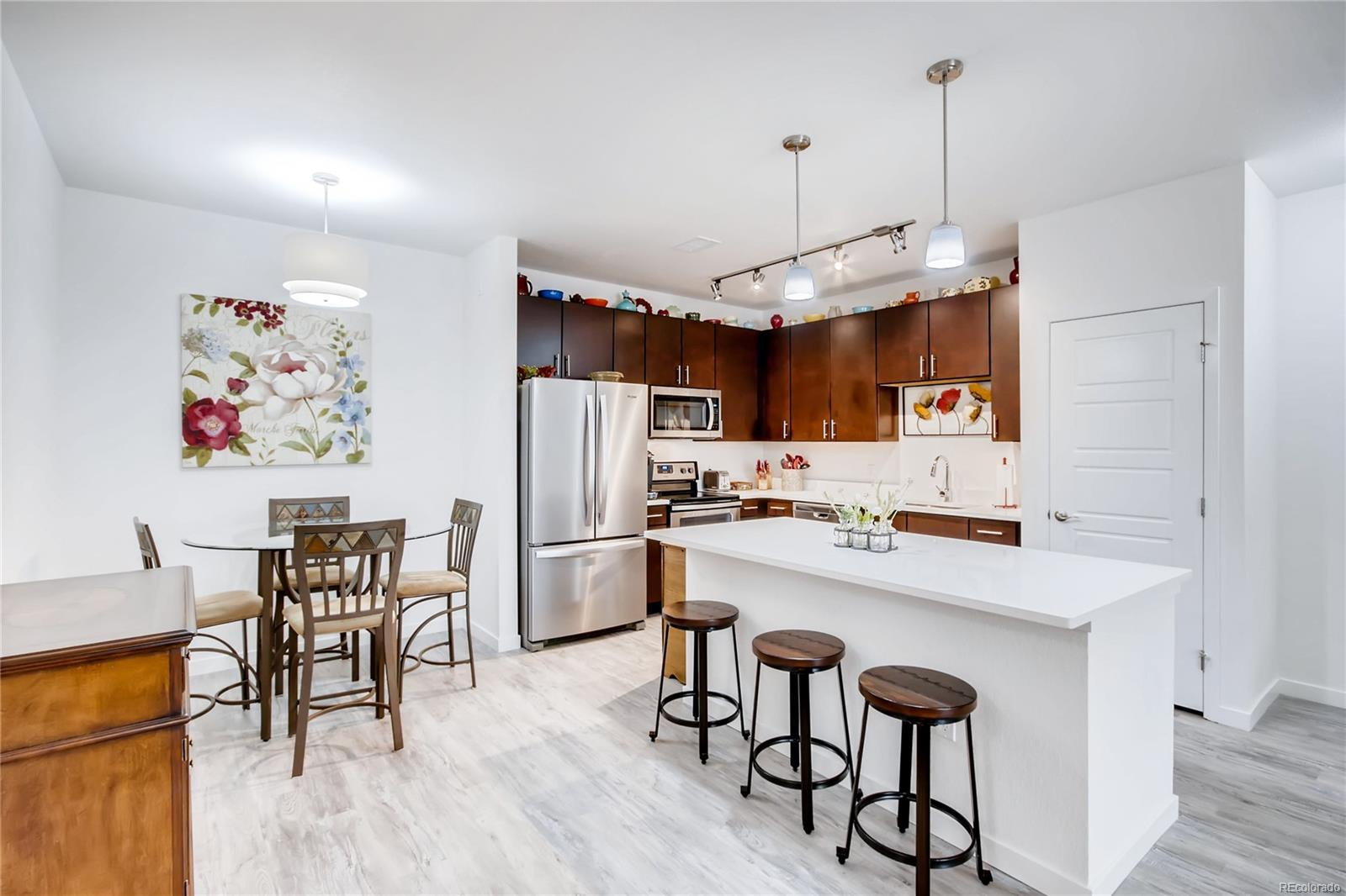 BEAUTIFUL CONTEM,PORARY KITCHEN WITH ISLAND, OPENING ONTO DINING ROOM