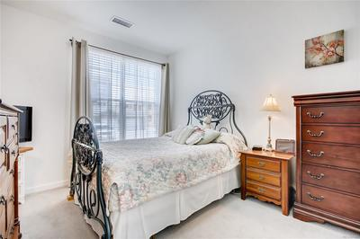 MASTER BEDROOM.  THIS IMAGE HAS SLIGHTLY DISTORTED THE SIZE.   THIS IS A LARGE BED AND LOOKS SMALL.  SORRY, BUT IT IS A BAD PHOTO FROM THE PROFESSIONAL PHOTOGRAPHER.