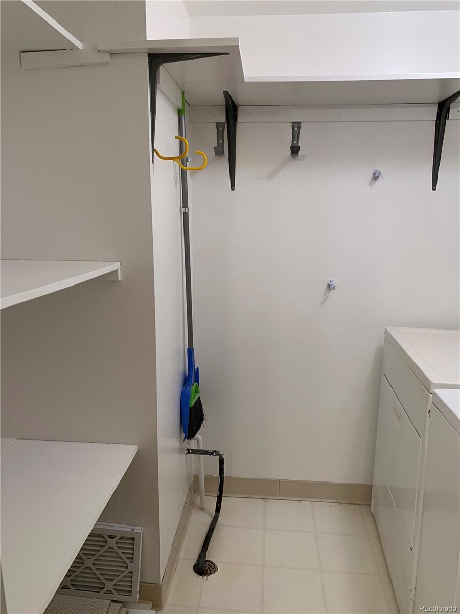 Newly Painted Laundry Room with Plenty of Storage!