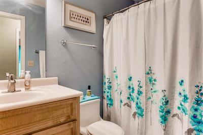 Upstairs bathroom with tub and shower.