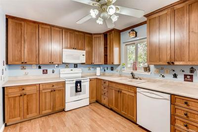 Nice cabinets and all appliances stay.